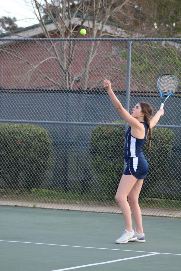 Julianna+Ladner+serves+in+the+district+tournament.+