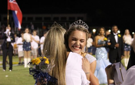 The 2019-2020 homecoming queen Hannah Dear is crowned by St. Joe alumna Luckett Nixon, the 2018-2019 homecoming queen.