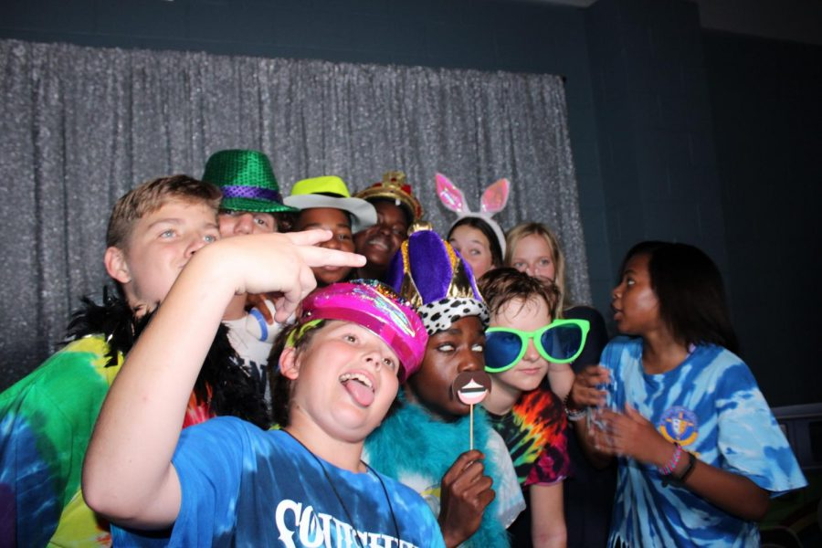 Eighth grade students pose at the middle school dance.