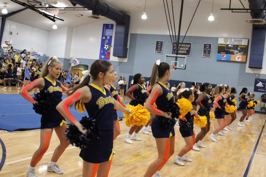 The St. Joe cheerleaders perform at the pep rally on Friday.