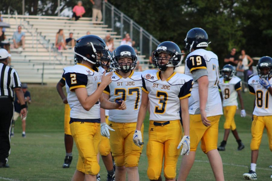 From left to right: Eighth graders Emile Picarella, John Clarke, and Parker Davis during the middle school football game against St. Andrews.