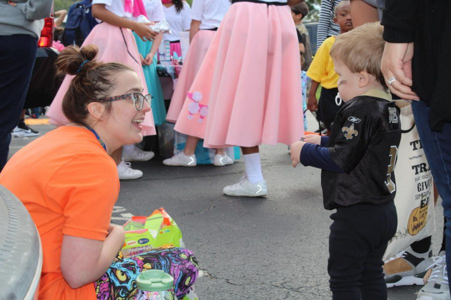 Mrs. Jenna Murphy passes out candy during St. Joe's 3rd Annual Trunk-or-Treat.