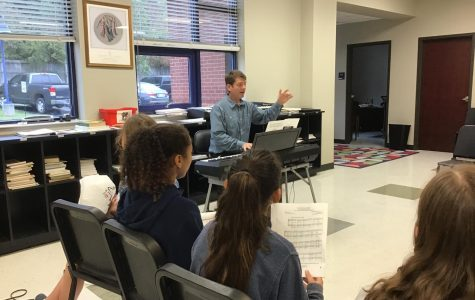 Mr. Hrivnak instructing his 7th grade choir class. Hrivnak is being featured as teacher of the week for The Bear Facts.
