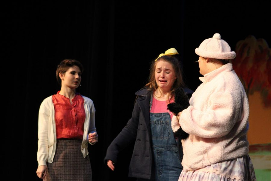 From left to right: Kim Kaiser, Hannah Dear, and Mary Kathryn David share the stage during the opening performance of St. Joe's annual fall play.