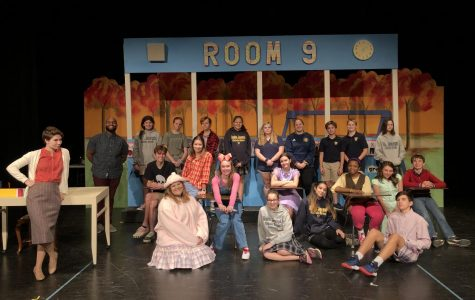 "The cast crew of the St. Joseph Catholic School stage production of ""Junie B. Jones is NOT a Crook."" Back row from left: Mr. Madison Upendo, the St. Joe theater teacher and play's director; Loria Williams; Ava Schuetzle; Anna Grace Starnes; Anna Veston Deer; Abigail Hardeman; Molly Moody; Turner Brown; Connor Odom; and Addie Welshans. Second row sitting in desks from left, Anderson Nixon, Annalise Rome, Hannah Dear, Georgia Conrad, Natalia Igwebuike and Andrew Bain. Sitting on the floor, Mary Kathryn David, Madalyn Weisenberger, Iliana Ramos, Meredith Morrow and Heath Dodson. Leaning against the desk on the far left is Kim Kaiser."