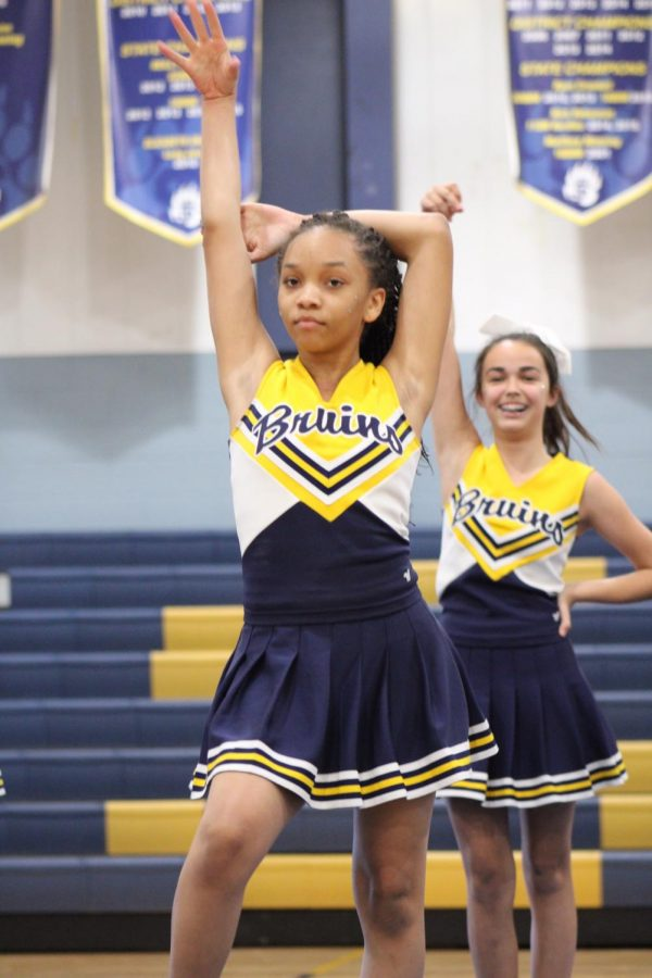 Seventh+grader+RaNiya+Ruffin+performs+with+the+middle+school+cheerleaders+during+the+pep+rally.