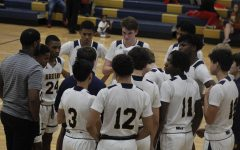Bruin basketball players huddle up.