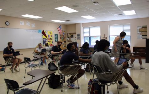 A senior English class Receives instructions on the first day of school.