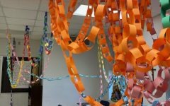 The seventh-grade class came, who came in third place, hung their paper chain in Mrs. Terri Cooper's theology classroom.