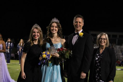 From left to right: 2019 homecoming queen Hannah Dear, 2020 homecoming queen Bianca McCarty, Mr. Tim McCarty, and St. Joe principal Dr. Dena Kinsey.
